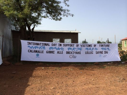 June 26 - International Day in Support of Victims of Torture - banner in the Adi Harush refugee camp in Ethiopia